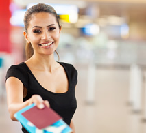 girl with passport smiling